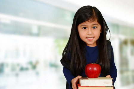 pre teen girls: Young girl at school who is smiling