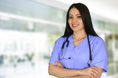 medical worker: Minority nurse working at her job in a hospital