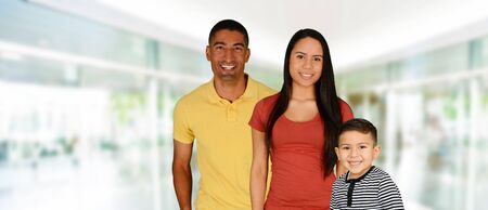 foster: Young family together inside of their home