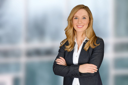 successful woman: Young successful woman with crossed hands looking at camera