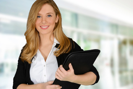 successful woman: Young successful woman holding file holder