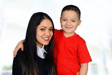 Mother posing with her young son while smiling Banco de Imagens