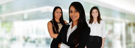 leader lead: Business woman at the office ready to work Stock Photo