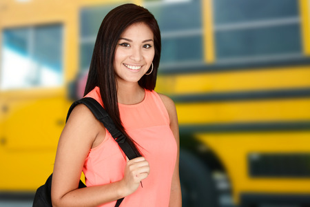 high school girl: Student going to class at her high school Stock Photo