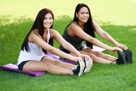 boot camp: Group of people doing a boot camp workout outside