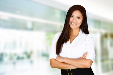 confident: Business woman at the office ready to work Stock Photo