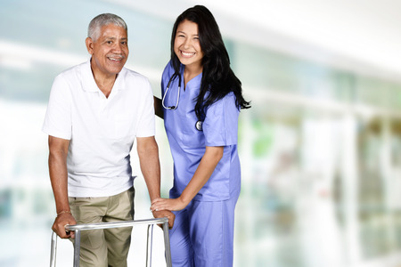 citizen: Health care worker helping an elderly man Stock Photo
