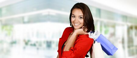gift spending: Woman shopping with bags at the mall Stock Photo