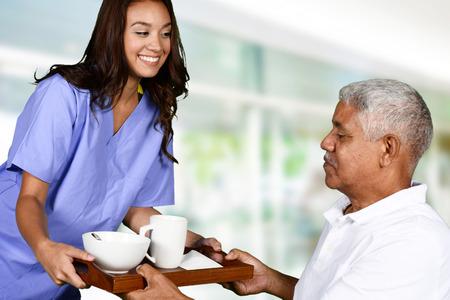 Health care worker helping an elderly man Standard-Bild