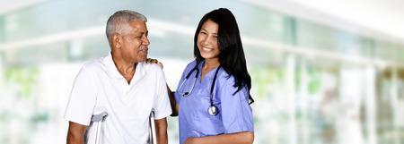 worker man: Health care worker helping an elderly man Stock Photo