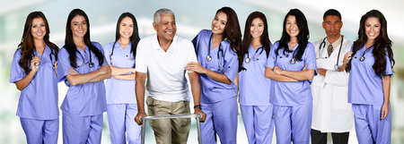 Group of doctors and nurses set in a hospital with a patient Stock Photo