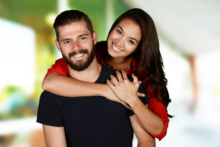 Man and woman posing together inside their home Imagens