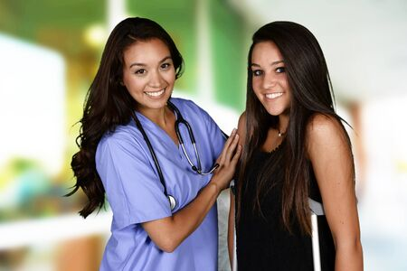 patient in hospital: Nurse with a patient in the hospital