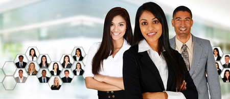 black professional: Businesswoman working in an office with her team