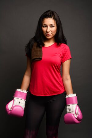 kick boxing: Woman doing a kick boxing workout to get fit