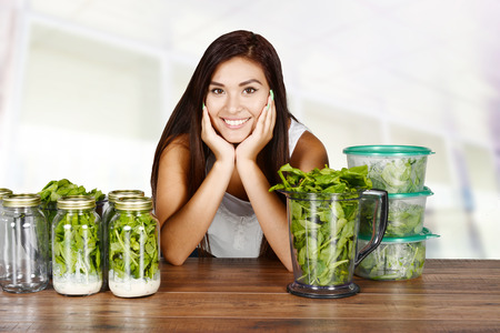 raw food: A woman doing meal prep for the week Stock Photo