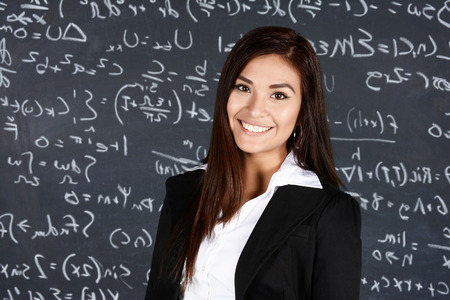 Teacher at school in the classroom ready for work Stock Photo