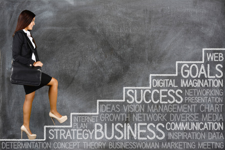 Businesswoman who is working to reach her goals Stock Photo