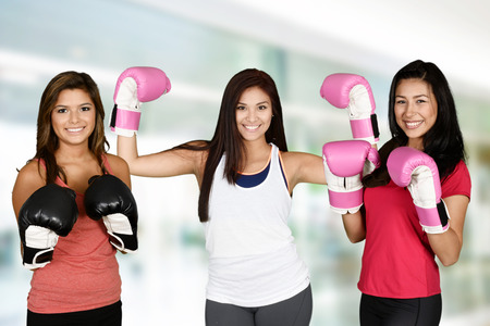 female kick: Group of people doing a kick boxing workout
