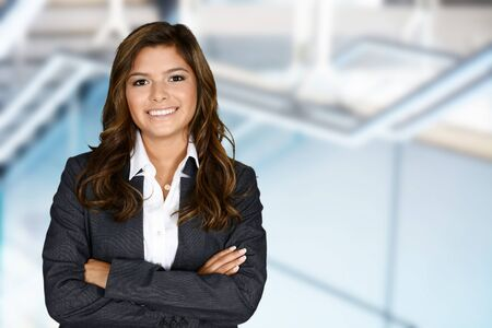 hispanic woman: Business woman at the office ready to work Stock Photo