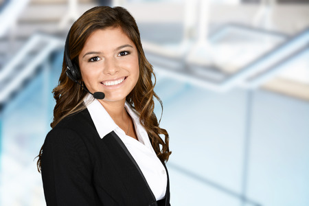 Young woman giving help as a customer service employee