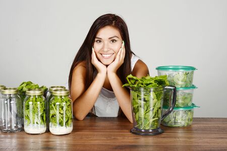 A woman doing meal prep for the week Stock Photo