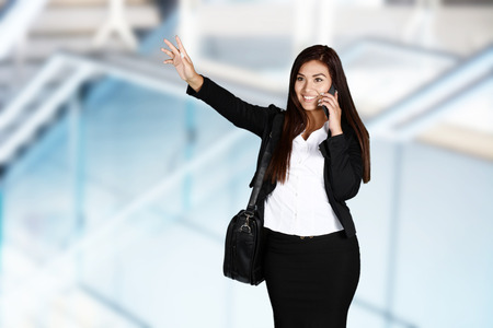 hailing: Business woman catching a ride in taxi Stock Photo