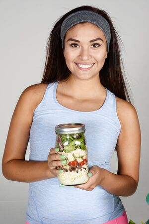 weight loss plan: A woman doing meal prep for the week Stock Photo