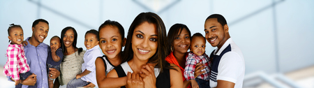 diverse family: Group of different families together of all races