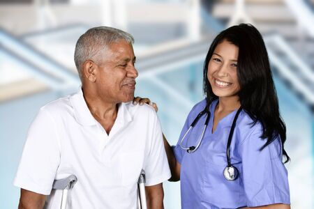 Nurse giving physical therapy to an elderly patient Stock Photo