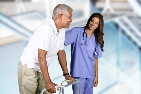 therapy: Nurse giving physical therapy to an elderly patient Stock Photo