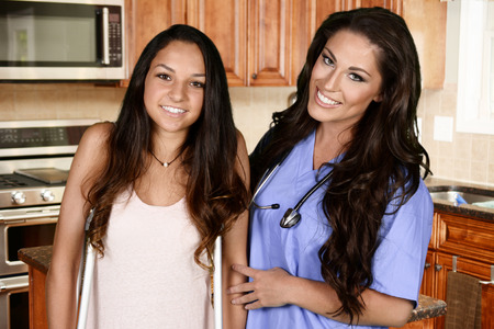 health care worker: Home health care worker and a teenage girl