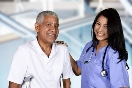 Nurse giving physical therapy to an elderly patient Archivio Fotografico