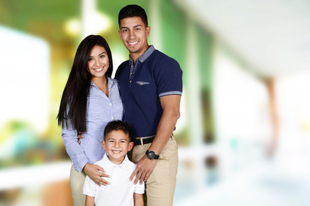 family together: Young family together inside of their home
