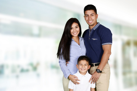 Young family together inside of their home