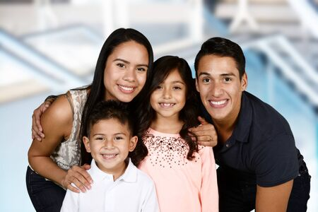 family happy: Young hispanic family who love being with each other Stock Photo