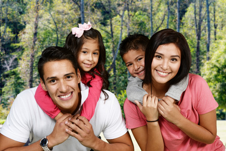 a young family: Young hispanic family who love being with each other Stock Photo