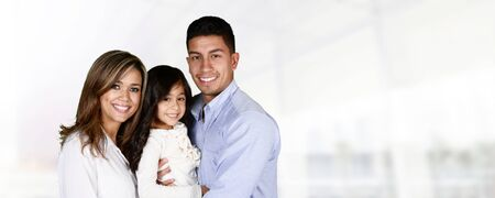 smiling: Young hispanic family who love being with each other Stock Photo
