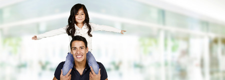 hugs: Young hispanic family who love being with each other Stock Photo