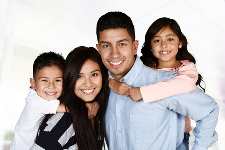Young hispanic family who love being with each other Archivio Fotografico