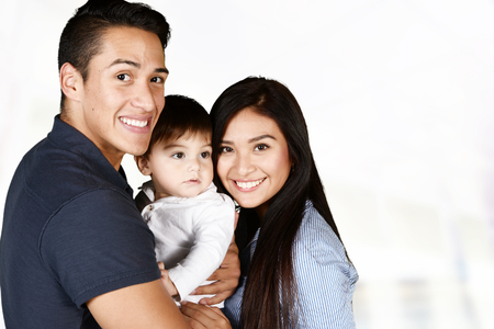 Young hispanic family who love being with each other Stock Photo