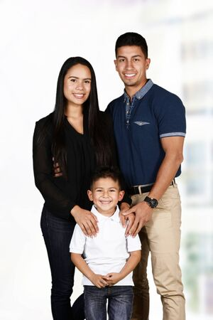 minority couple: Happy young couple who are standing with their son
