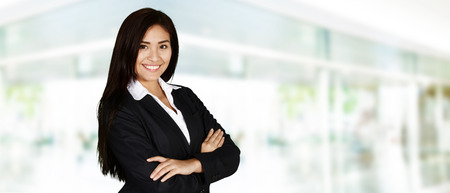 business woman working: A woman who is working at a place of business Stock Photo