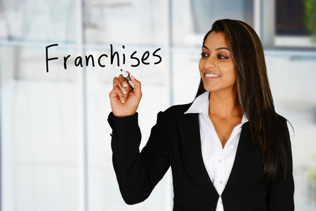 franchises: Confident businesswoman who is selling business franchises