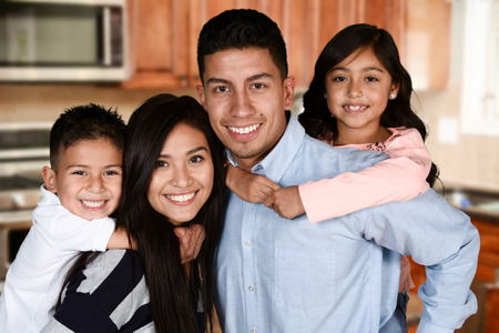 hispanic kids: Happy young couple who are standing with their son