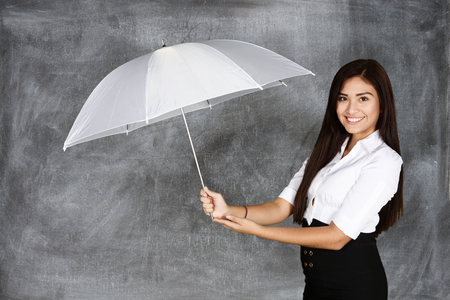 happy workers: Confident businesswoman who holding an umbrella