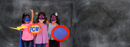 Group of children at school dressed at superheroes Stock Photo