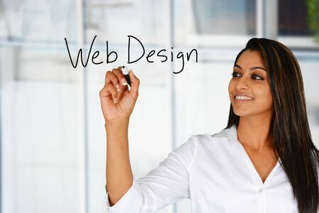 web designing: Woman who is designing a web site Stock Photo