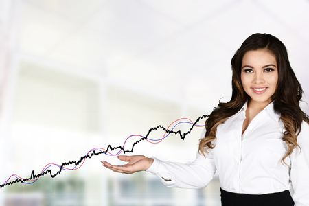 smart investing: Confident businesswoman who is working at the stock market