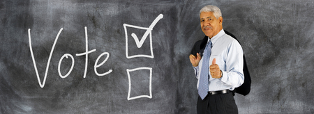 voting: Old man with Voting boxes displayed on a chalk board Stock Photo